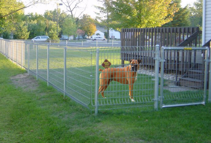 What type of fence will contain my dog?